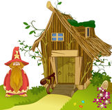 Fabulous house of  made of twigs. The illustration shows  fabulous house of  made of twigs and funny cartoon gnome. Illustration can be a gaming background to Royalty Free Stock Photos