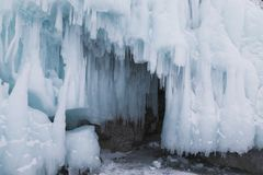 Fabulous ice cave on lake Baikal. Eastern Siberia,. Russia stock photos