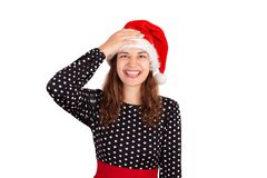 Fabulous joyful woman showing tongue and looking down laughs hand on the head. emotional girl in santa claus christmas hat isolate royalty free stock image