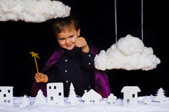 Fabulous kid throws the snow over the city on Christmas Stock Photo