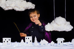 Fabulous kid throws the snow over the city on Christmas Stock Images