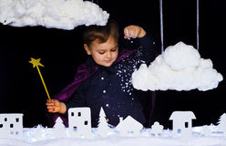 Fabulous kid throws the snow over the city on Christmas Royalty Free Stock Image