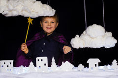 Fabulous kid throws the snow over the city on Christmas Royalty Free Stock Photography