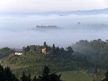 Fabulous landscape of the foggy morning in Tuscany Stock Images