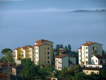 Fabulous landscape of the foggy morning in Tuscany. Stock Photo