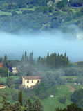 Fabulous landscape of the foggy morning in Tuscany. Stock Photography
