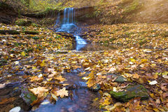 Fabulous landscape of stone and waterfall in the autumn forest ( Stock Photo