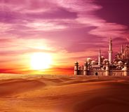 A fabulous lost city in the desert. On beautiful sunset sky background Stock Images