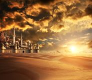A fabulous lost city in the desert. On beautiful sunset sky background Royalty Free Stock Photography