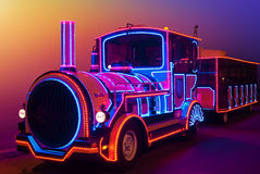 Fabulous, magical locomotive glow in the dark colored lights Royalty Free Stock Photos