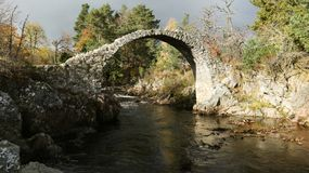 The fabulous old packhorse bridge in Carrbridge in the Cairngorms National Park is the oldest stone bridge in the Highlands of Sco stock photo