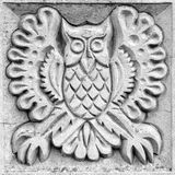 Fabulous owl, bas-relief Stock Photography