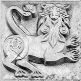 Fabulous panther, bas-relief. Fabulous panther, a stone bas-relief on the wall stock photo