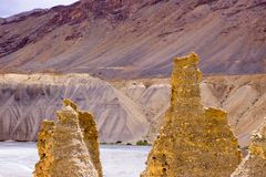 Fabulous sandy pyramids by the river in mountains royalty free stock photography