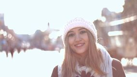 Fabulous smile. Girl stands on the Arbat, wind blows in the face. She dreams about something. She looks great with her fabulous smile. Perspective of the main stock video footage