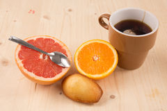 Fabulous and very sweet breakfast consisting tea, fresh fruits, cakes Royalty Free Stock Photo