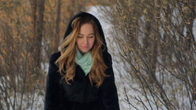 Fabulous woman walks through forest, background of winter landscape stock video footage