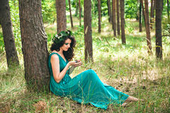 Fabulous young womanl in the forest Royalty Free Stock Photography