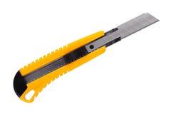 A faca amarela dos artigos de papelaria Imagens de Stock Royalty Free