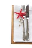 Faca e forquilha com ajuste da tabela dos starfish Imagens de Stock Royalty Free