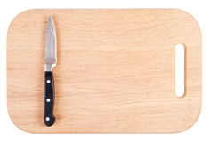 Faca em uma placa de desbastamento de madeira foto de stock