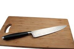 Faca para a carne e a placa de estaca Fotografia de Stock