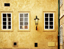 Facade. Three windows and a street lamp in central Prague, Europe Stock Image