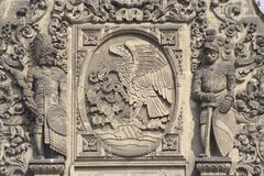 Facade. Eagle aztec warrior and spanish conqueror as part of the main facade of the national palace in mexico city royalty free stock photos