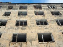 The facade of an abandoned apartment house Royalty Free Stock Photography