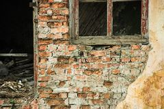 Facade of an abandoned brick building. Is close royalty free stock image