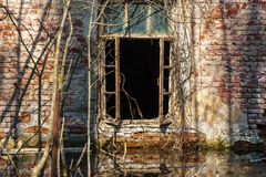 Facade of an abandoned brick house stock photography