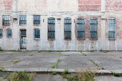 Facade of abandoned building with windows and door, in Davenport, Iowa, USA. Facade of an abandoned building with windows and door, in Davenport, Iowa, USA stock images