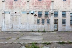 Facade of abandoned building with windows and door, in Davenport, Iowa, USA. Facade of an abandoned building with windows and door, in Davenport, Iowa, USA royalty free stock image