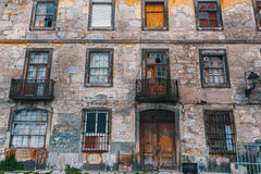 Facade of abandoned house buildings, Porto, Portugal. Royalty Free Stock Photo