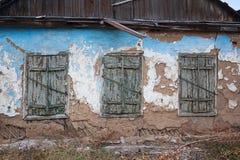 Facade of an abandoned house Stock Photos