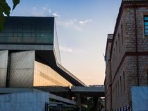 Facade of Acropolis museum facing Acropolis reserch center mirroring amazing sunset stock images