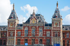 Facade of the Amsterdam Centraal Station in sunny day, Netherlands. Royalty Free Stock Images