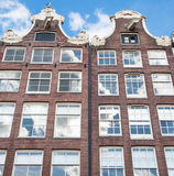 Facade of the Amsterdam17th century residence building in the midday. Stock Image