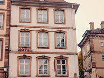 Facade of an ancient building  large Windows of the European city Stock Photos