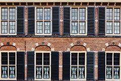 Facade of the ancient building made of red brick royalty free stock photography
