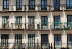 Facade of an ancient building, with rows of balconies. A detail of the Facade of ancient buildings, with rows of balconies, in segovia, spain, landscape cut stock photography