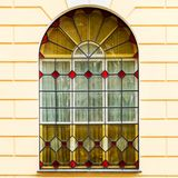 The facade of an ancient building with stained-glass windows col. Or. Architecture Royalty Free Stock Image