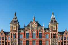 Facade of the ancient central train station in Amsterdam Stock Photography