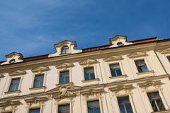 Facade of ancient house on blue sky background Stock Photography