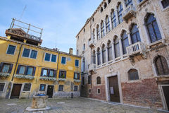 Facade of an ancient house in Venice Stock Images