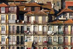 Facade of ancient palaces, Porto, Portugal. Facade of ancient palaces near the river, Porto, Portugal Royalty Free Stock Images
