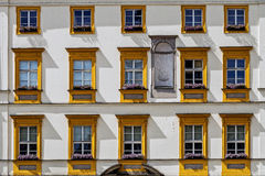 Facade of ancient tenement Stock Image