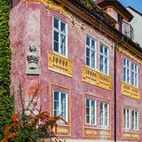 Facade of an ancient tenement Stock Images