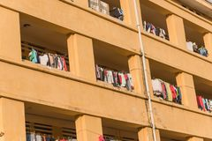 Facade of apartment and dormitory sun drying hanging clothes lin. Close-up of university dorm with sun drying hanging clothes line in dense of apartments in Stock Image