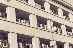 Facade of apartment and dormitory sun drying hanging clothes lin. Close-up of university dorm with sun drying hanging clothes line in dense of apartments in Royalty Free Stock Photos